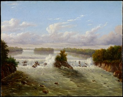 waterfall with rock outcropping at center with bush; rocky bank on L and R; gold frame