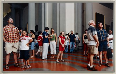 No. 9632; people looking up at object in museum; grey wood frame with Plexiglas