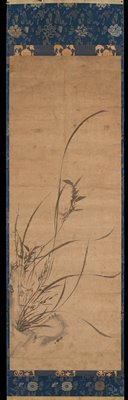 delicate orchid fronds with reed-like flowers and stylized rock at LL