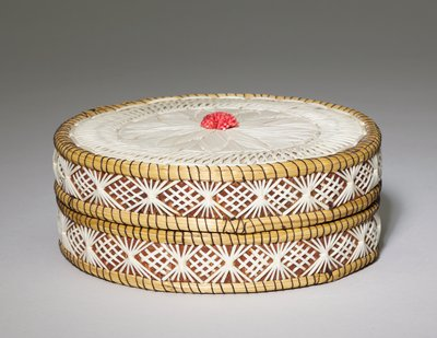 drum shaped box on birch bark body; flat top decorated with floral rondel and basket weave-like border in white quills; central element in flower made of small bits of red quills; one band around edge of cover and one band around body of box with alternating X-motifs and basket weave diamonds with white quills