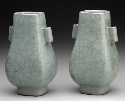 rounded 4-sided pear shape with a short foot; 2 small hollow tubelike vertical handles; blue-green crackle glaze