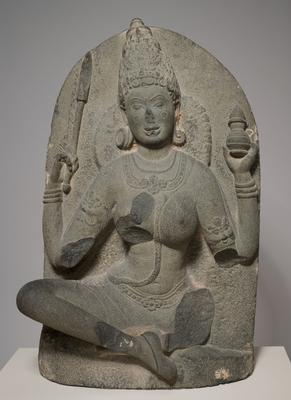 A yogini bearing a jar.  One of 19 known sculptures from a set originating in Kanchipuram, Tamil Nadu, India.