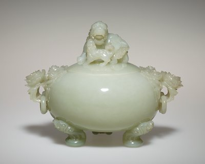 Vase, covered globular temple, of jade, with standard. Surmounted by carved tiger and cub. Small rings hang from each of the two handles, which are composed of three peonies. Stands on three curved feet of conventionalized design.