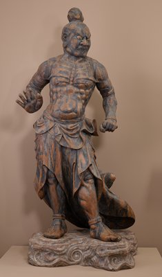 Naraen Kongo, standing figure with arms down, mouth closed. Made of Hinoki wood in yosegi technique of multiple block construction with traces of gesso and polychrome.
