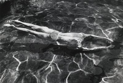 man wearing striped swimsuit underwater