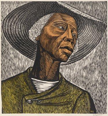 Bust-length portrait of a Black female field worker