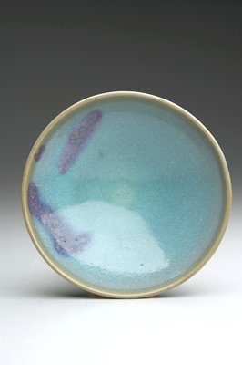 conical bowl with blue glaze and splashes of purple glaze on interior and exterior; with storage box