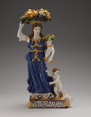 Terracotta, Italian XVIc cat. card dims H 27 x L 8 x W 12'; Figure carries on her head a basket filled with fruit and in her hand a brimming cornucopia. Little boy at her feet turns to her for protection from a barking dog. Blue gown with golden yellow decoration; yellow, green and violet fruit.