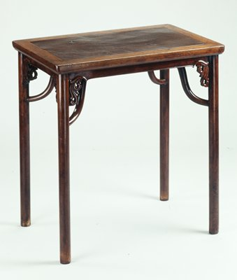 Round, straight legs; curving support from each leg to underside of tabletop; six scroll elements at corners of short apron