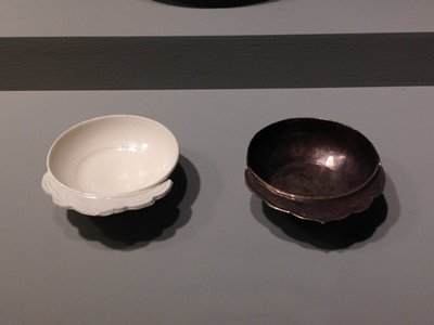 white, shallow dish with scallop-edged flange, with lightly-impressed design
