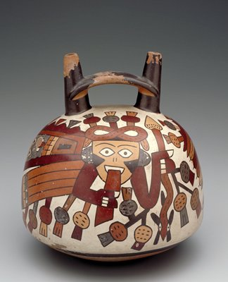 Double-spout vase painted in polychrome with two couchant winged figures. The heads wear an elaborate coiled headdress tipped with plant forms that spring from other parts of the body and from the serpent staff held in left hand of figure. Painted face with long projecting tongue. Wings of figures are decorated with human heads and terminate in feathers.
