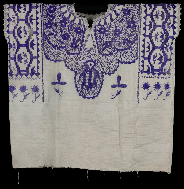 woven with white-on-white stripes; neckline and sleeves trimmed in crochet; purple embroidery--same on each side--of flower, geometric and organic designs