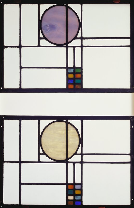Clear rectangular panes with a yellow circle at one long side and eight small colored rectangles (blues, yellow, aqua, orange and swirled green and pink) at opposite long side