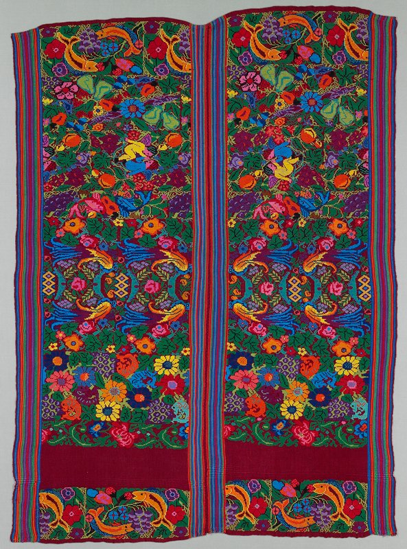 two panels sewn together by hand; maroon ground woven with warp stripes at each selvedge (four selvedge). Bright multicolored designs of flowers, fruit, leaves, birds, fish and pairs of angels.