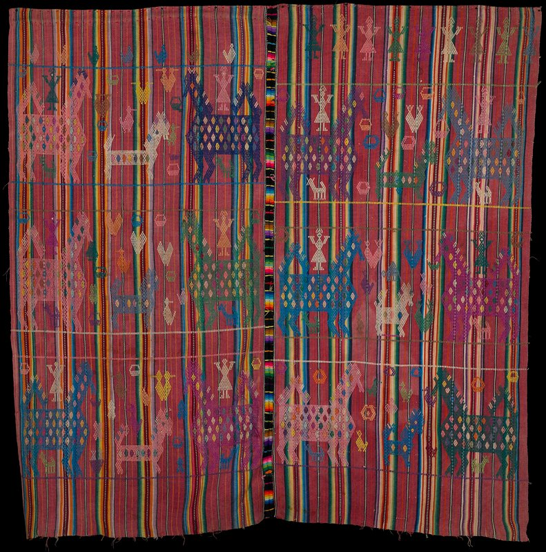 two panels of multicolored stripes (predominately pink) sewn together with thick multicolored stitches; woven overall with animals, birds, people, baskets and hearts of various sizes and in various mainly pastel colors
