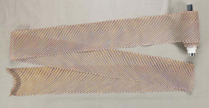 thin purple and white diagonal stripe on a yellow background