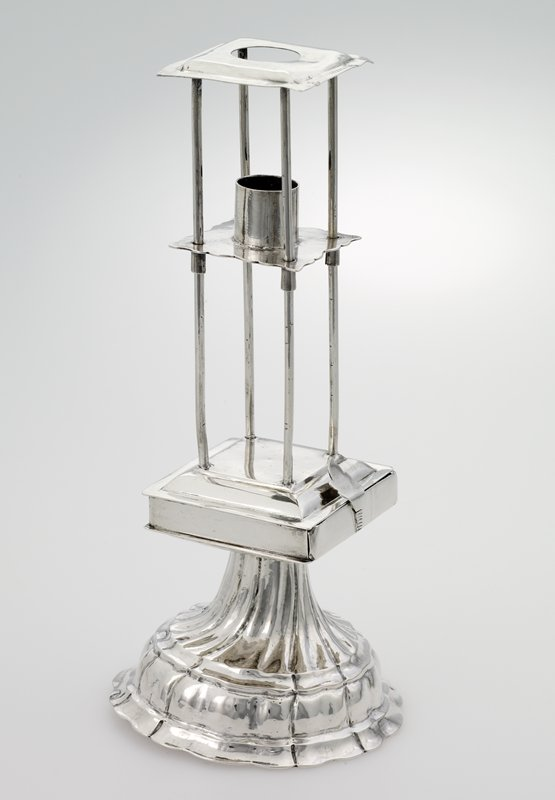 "domed circular base with repousee spiral fluting, supporting a 2-1/8"" square box housing a removable drawer with four compartments for spices and an escalloped sconce which holds havdalah candle which slides along four wires at the candle is used to the stop straight sconce"