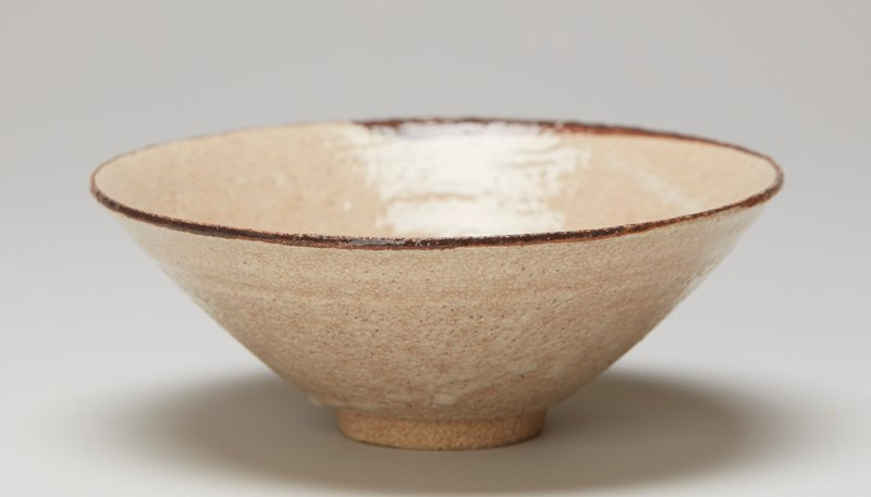 tea bowl; ring foot; wide, outward-flaring form; cream-colored glaze with brown rim ring