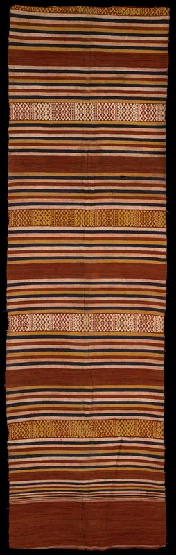 striped cloth in rust, brown, tan and gold bands of stripes separated with band of geometric design