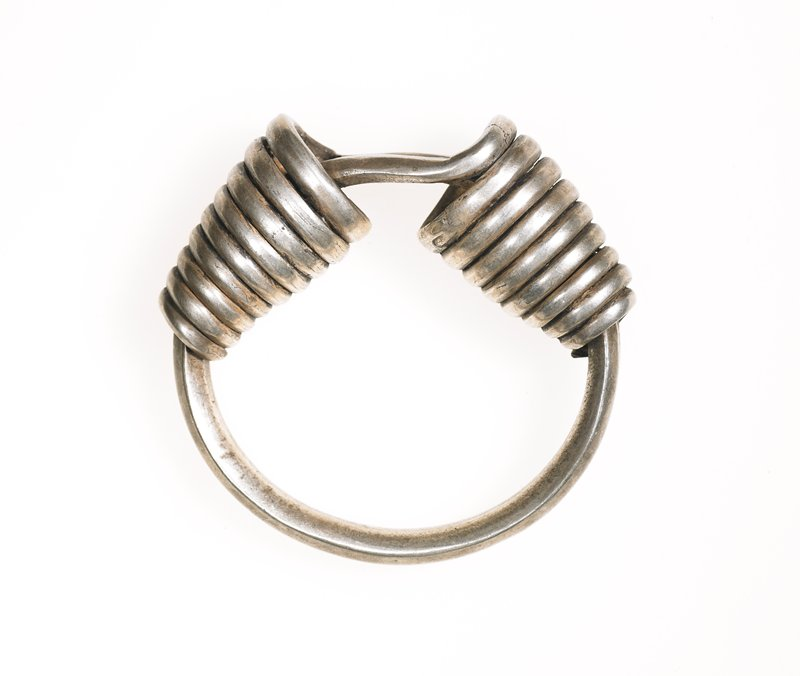 bracelet; heavy, single length of silver twisted at either end to form a circle with spiral wrap