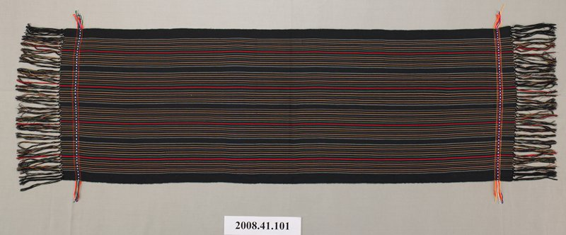 black self fringed shawl with stripes in blue, white, green, red, yellow; woven band at either end five stripes wide