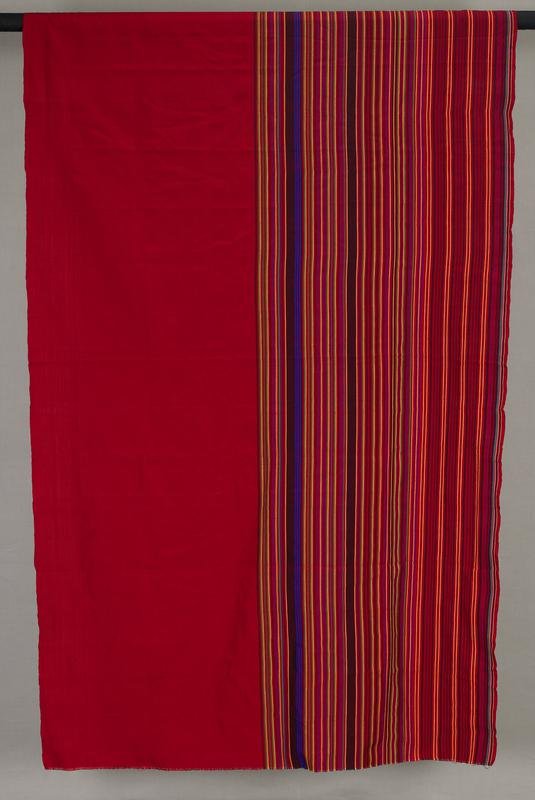 red panel with bright stripes in yellow, green, purple, black, orange on approximately half of panel