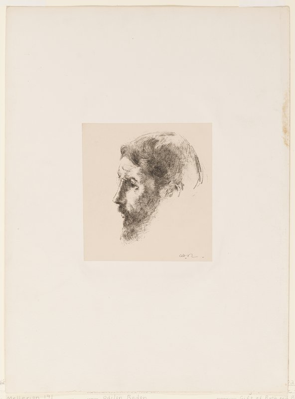 head of man with beard, pointed nose, rather bowl-shaped haircut and glasses, in profile from PL