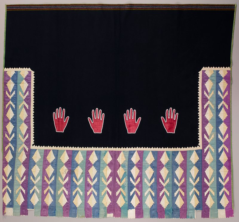 dark blue wool with yellow, red and white stripes at one end; appliquéd silk ribbon in white, lavender, light blue and medium blue forming U-shaped section with strips of symmetrical stepped flower and leaf designs; 4 red silk hand silhouettes, trimmed in white beads; green silk trim