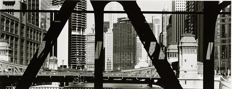 view of skyscrapers in downtown Chicago at LaSalle Street through iron beams