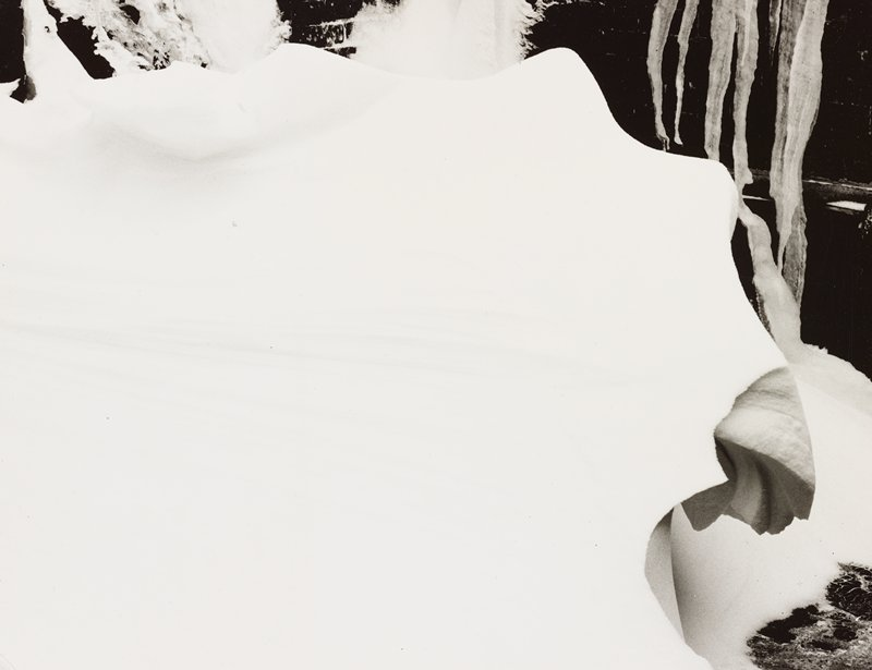 snow drift with some horizontal patterns; icicles, ULC; irregular snow and ice formations at top and LRC