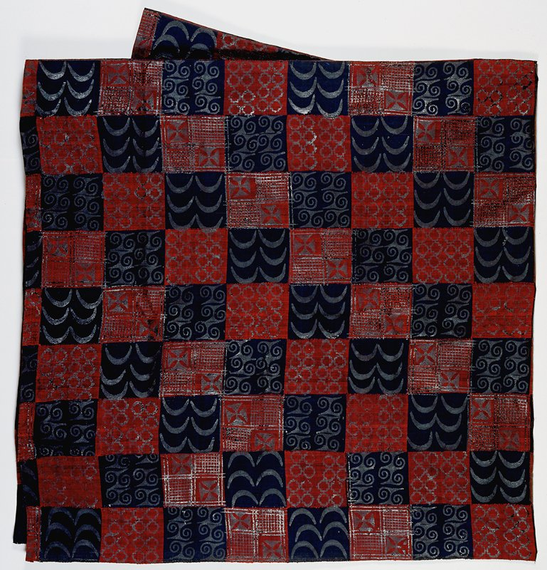 red/black squares with surface geometric designs printed/stamped on fabric