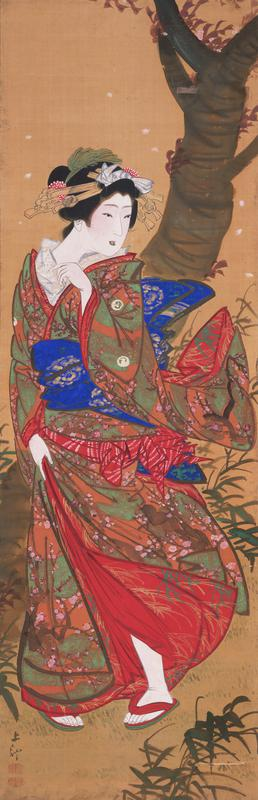 woman in red kimono with blue, orange and green; she is holding kimono closed from the wind; treee behind her on R