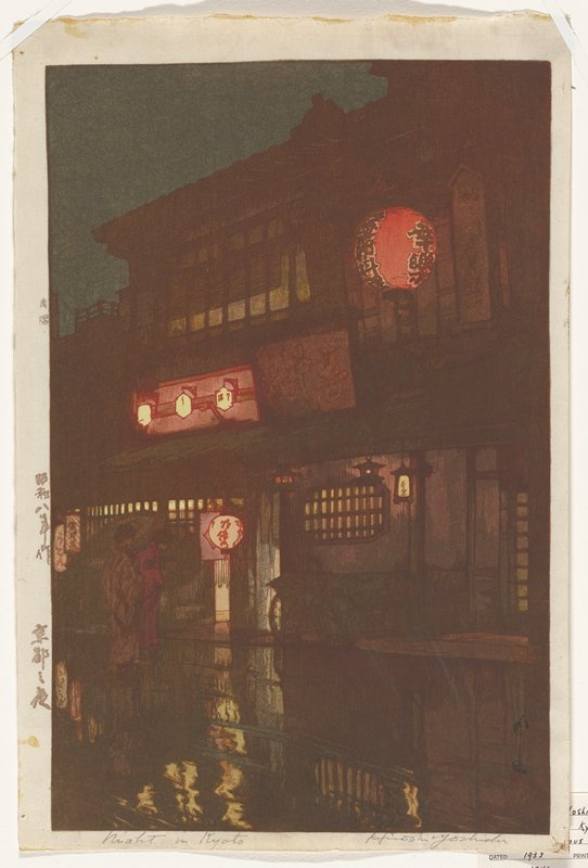 night scene: two women in kimono with umbrella peer into a shop window at LL; reflection from warm indoor lights on wet street; in middle ground, a multi-story building with bicycle parked in front and illuminated paper lanterns contrasts against the dark night scene