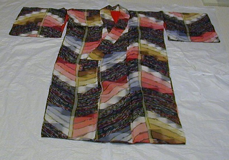 kimono with two types of wavy design: wavy green, red, gray and yellow lines on black base, and chevron design of wide lines in yellow, orange, red, pink and gray gradients