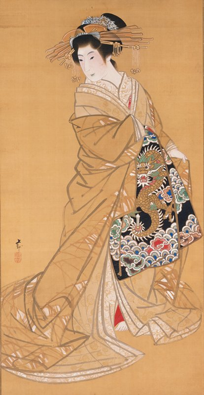 standing woman looking toward PR; hair in an updo with decorative sticks and bells; woman wears a tan kimono with white organic leaf-like designs; obi in front with dragon design in bold colors on black; red underskirt visible above PL foot at opening of kimono; ivory roller ends