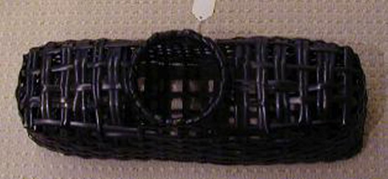 horizontally oriented black rectangular basket; raised round mouth; black lacquered copper lined cylinder