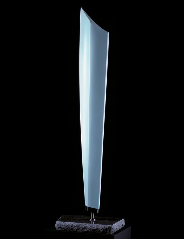 very tall, graceful form; five edges rising from a narrow bottom into a single, beveled point at top; mounts by a metal post to a marble slab; light blue/green color (seihakuji); marble has a polished top with rugged edges