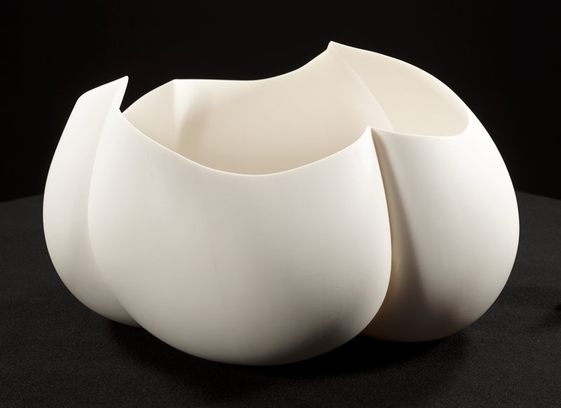 cloudlike, organic, white porcelain vessel; four pointed scallops at top mirroring contours of form; incised lines separate the four segments