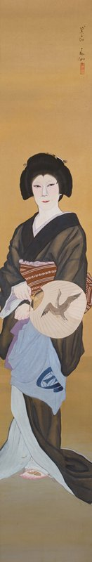 male actor dressed as a woman; standing figure wearing black silk kimono with light blue underlayer; brown obi with white patterning; fan with flying duck; bare PL foot beneath hem of kimono