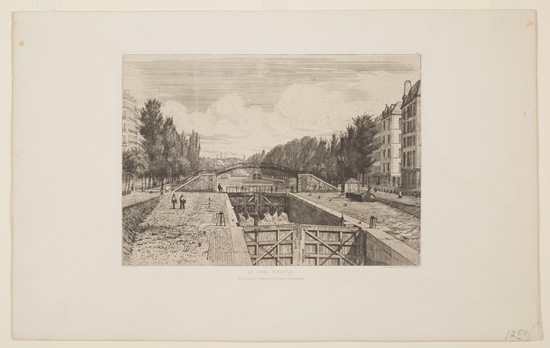canal with arcing bridge of wrought iron and brick in middle ground; paved brick walkways on either side of canal; boats in distance; trees beyond bridge on both side of waterway, with buildings; a few pedestrians