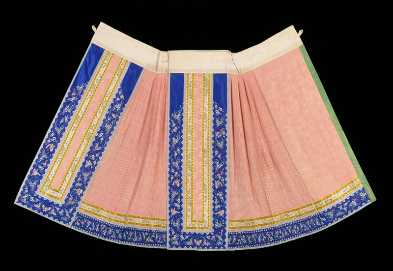 Two panels which unbutton into separate parts; pink silk with small overall stitched-down pleats; trimmed with tan and yellow floral ribbon, blue silk embroidered with flowers and moths and light blue silk; partially lined with green