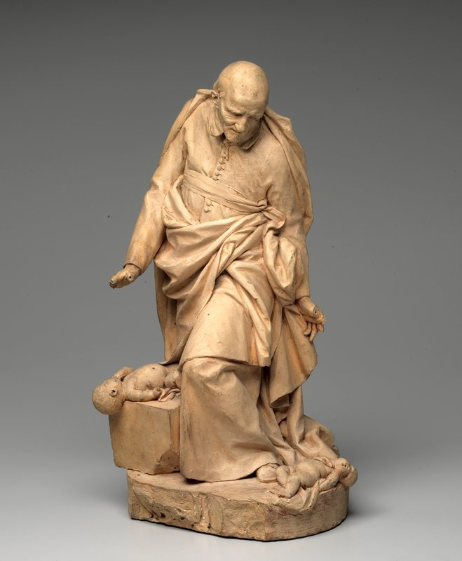 "Stouf's representation of the saint shows him standing and looking down at two dead infants at his feet. His facial expression registers his horror at he devastations of the ""Fronde""--the civil war of 1648-1653. The resultant life-size statue was the sculptor's first major work."