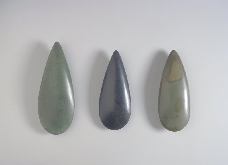 Teardrop shaped; green stone with brown and tan flecks