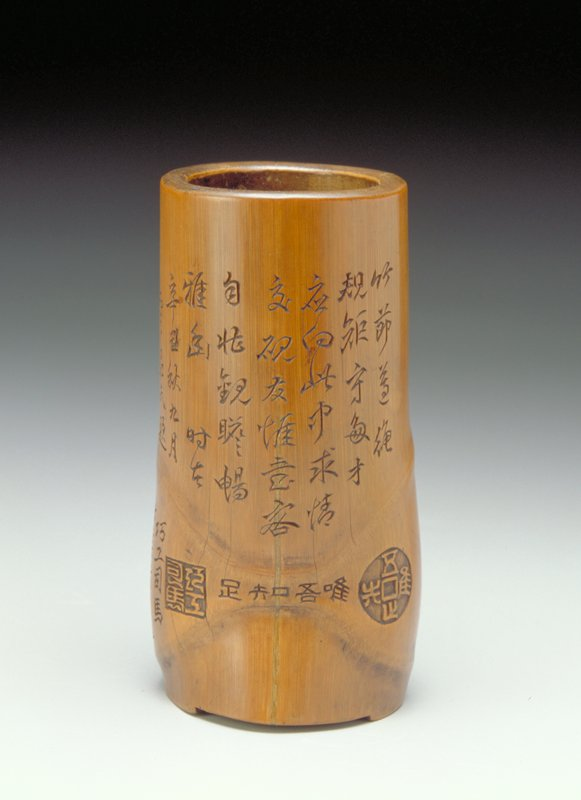 nodal section of bamboo forming a knee joint; slanted interior base with 3 low feet