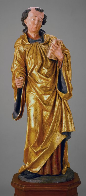 St. Leonard sculpture, gilt and painted wood, Italian XVc cat. card dims H 46-1/4' cat card changed back to Austria from Italian; Full-length figure holding a book in his left hand and should be holding a chain in his right, signifying his role as patron saint of prisoners.