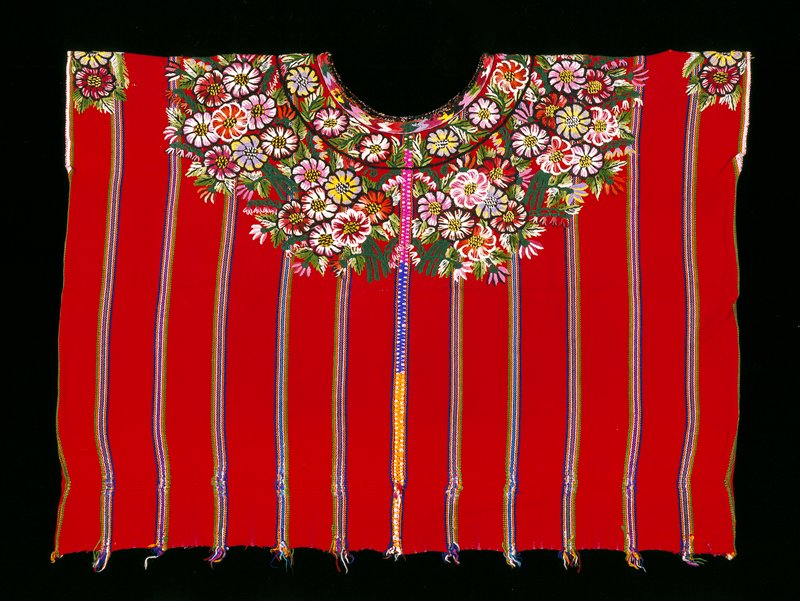 Two panel huipil with round cut neck opening; randa joins two sections; red ground cloth with very thin multi-colored warp stripes; elaborate floral embroidery encircles the neck and shoulder area. Surface ornamentation (Needlework)