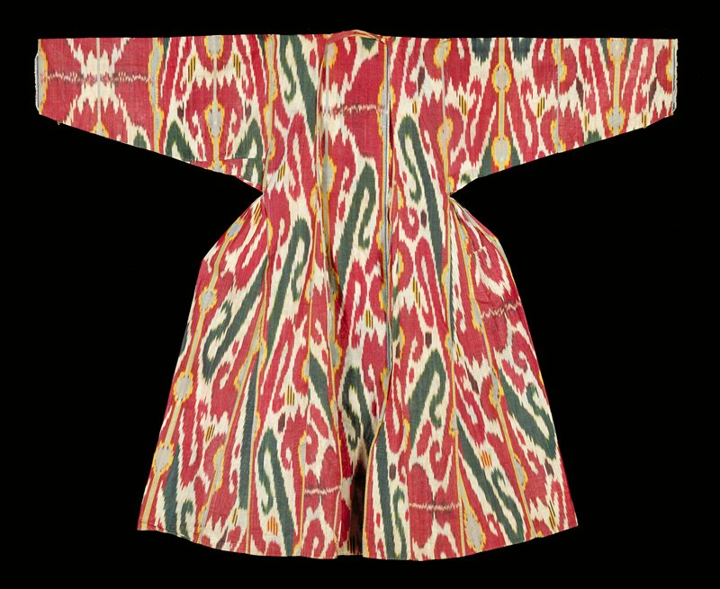 Ikat; long; gathers under arms, flaring out to a full skirt; red, brown, blue, white swirled designs