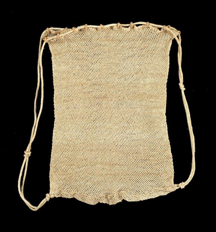 natural colored fish net knotting bag; pair of cords threaded through wicker rings around top of bag and woven through bottom of bag, leaving two cords on each side for handles