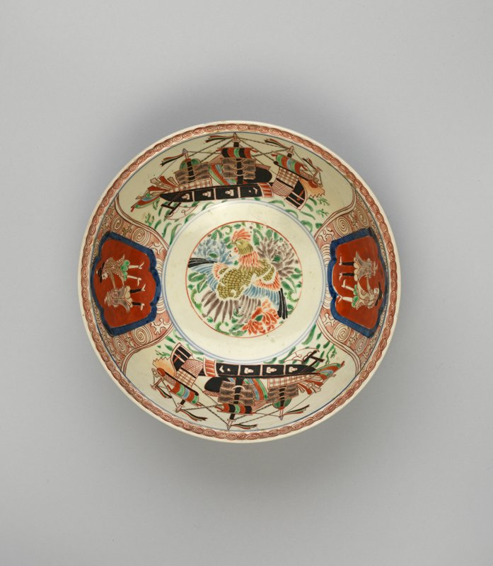 bowl with an image of a phoenix at center surrounded by chrysanthemums; vignettes on inner walls of bowl alternating between Western black gunboats with multi-colored sails, and images of two Western men, both with backs to viewer within crests; smaller ship and European men vignettes on outside with peony design
