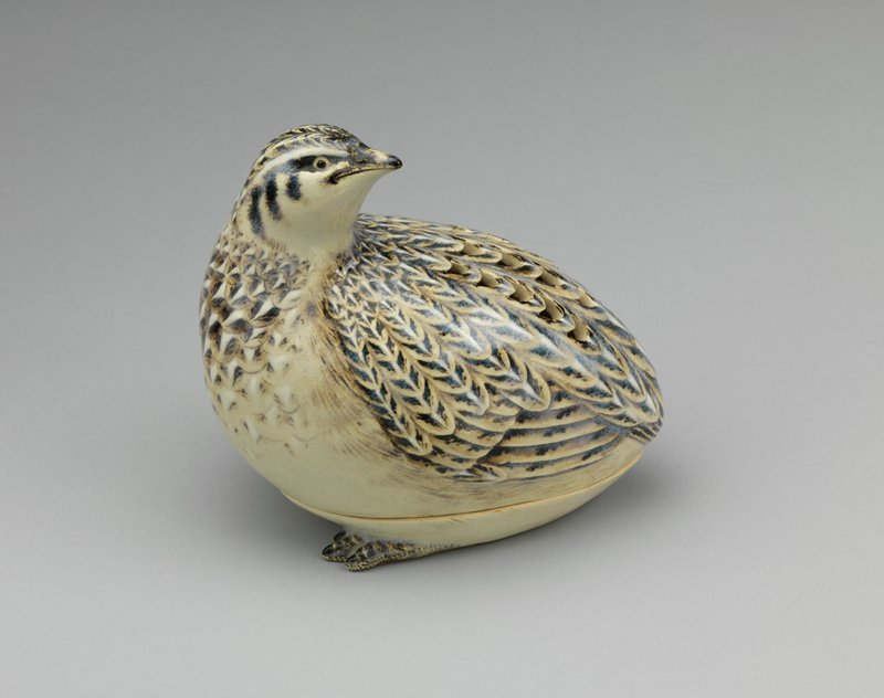 ceramic incense burner in the shape of a quail; made in two parts; scalloped cut-outs on back within feathers for venting